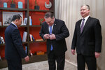 From left, Kim Yong Chol, a North Korean senior ruling party official and former intelligence chief, Secretary of State Mike Pompeo, and U.S. Special Representative for North Korea Stephen Biegun, arrive to pose for photographs at the The Dupont Circle Hotel in Washington, Friday, Jan. 18, 2019. (AP Photo/Carolyn Kaster)