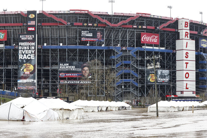 Damaged vendor tents sit in a flooded area near Bristol Motor Speedway as races for both the Truck Series and NASCAR Cup Series auto race was postponed due to inclement weather, Sunday, March 28, 2021, in Bristol, Tenn. (AP Photo/Wade Payne)