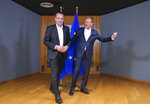 European People's Party member and Candidate for the next president of the European Commission, Germany's Manfred Weber, left, is welcomed by European Council President Donald Tusk ahead to a meeting on EU top jobs at the Europa building in Brussels, Thursday, June 13, 2019. (Olivier Hoslet, Pool Photo via AP)