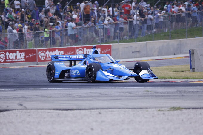 Alex Palou races in an IndyCar race at Road America in Elkhart Lake, Wisc., Sunday, June 20, 2021. (AP Photo/Jeffrey Phelps)