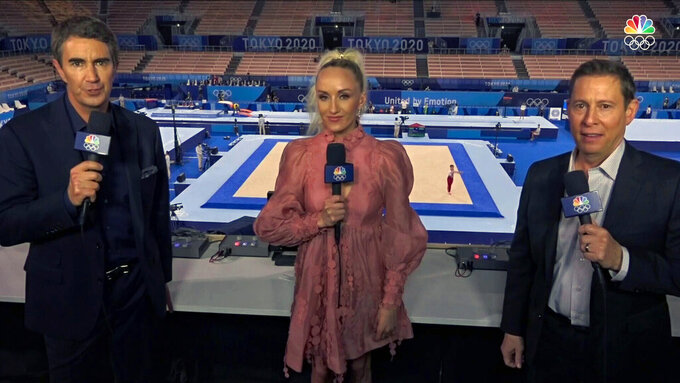 In this screengrab provided by NBC Sports, from left to right: Terry Gannon, Nastia Liukin and Tim Daggett call gymnastics for NBC Sports during the Tokyo Olympics, Monday, July 26, 2021. Gannon has become the voice of some of the most-watched sports at the Olympics. (NBC Sports via AP)