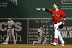 Boston Red Sox's Michael Chavis celebrates his games-ending single against the Colorado Rockies during the 10th inning of a baseball game Wednesday, May 15, 2019, at Fenway Park in Boston. The Red Sox won 6-5. (AP Photo/Winslow Townson)