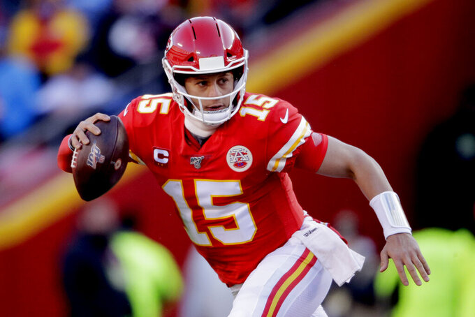 Kansas City Chiefs' Patrick Mahomes scrambles during the first half of the NFL AFC Championship football game against the Tennessee Titans Sunday, Jan. 19, 2020, in Kansas City, MO. (AP Photo/Charlie Riedel)