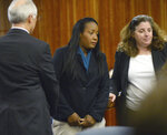 In this photo provided by the Daily Republic, Ina Rogers, center, appears in Solano County Superior Court in Fairfield, Calif., Wednesday, May 16, 2018, to face multiple charges of felony child abuse. Bail for a California mother of 10 children who officials say suffered long-term abuse was set at nearly $500,000 after the judge said she remains a danger to the kids. Prosecutors charged Rogers, 31, on Wednesday in Solano Superior Court with nine counts of felony child abuse, saying that she caused the children to be in a situation likely to produce great bodily injury and death. Her husband, Jonathan Allen, faces multiple charges of torture and felony child abuse. He has pleaded not guilty and remains in Solano County Jail on $5.2 million bail. (Robinson Kuntz/Daily Republic via AP)