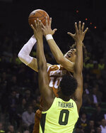 Texas forward Jaxson Hayes (10) shoots over Baylor forward Flo Thamba (0) during the first half of an NCAA college basketball game Wednesday, Feb. 27, 2019, in Waco, Texas. (Jerry Larson/Waco Tribune Herald via AP)