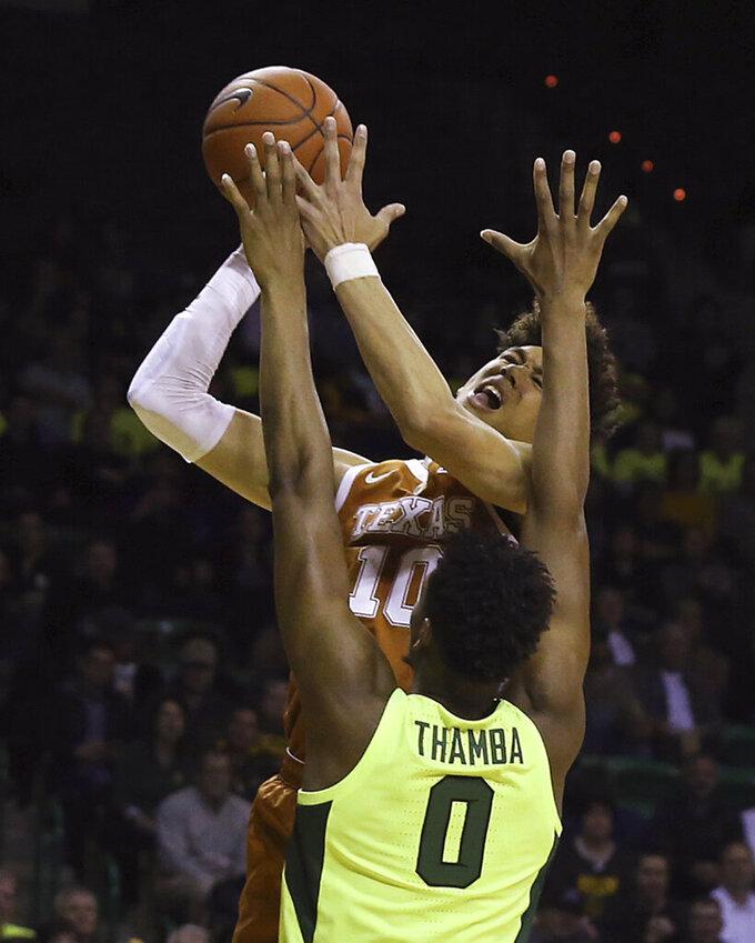 Texas forward Jaxson Hayes (10) shoots over Baylor forward Flo Thamba (0) during the first half of an NCAA college basketball game Wednesday, Feb. 27, 2019, in Waco, Texas. (Jerry Larson/Waco Tribune Herald via AP)
