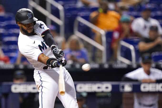 Miami Marlins' Bryan De La Cruz hits a single that scored Jazz Chisholm Jr. in the 10th inning to beat the New York Mets 2-1 in a baseball game Wednesday, Sept. 8, 2021, in Miami. (AP Photo/Wilfredo Lee)