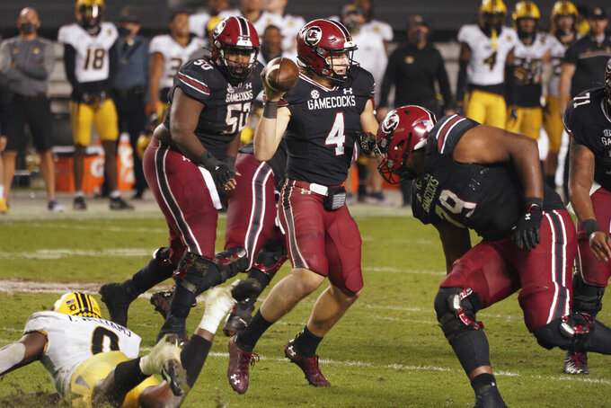South Carolina quarterback Luke Doty (4) looks to pass the ball during the second half of an NCAA college football game against Missouri, Saturday, Nov. 21, 2020, in Columbia, S.C. (AP Photo/Sean Rayford)