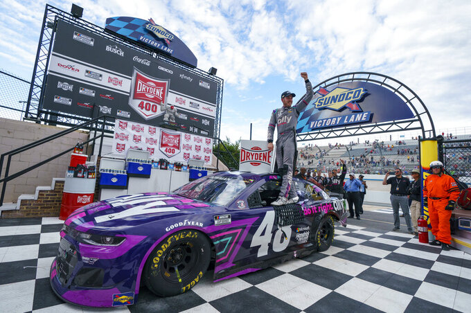 Alex Bowman celebrates his win following a NASCAR Cup Series auto race at Dover International Speedway, Sunday, May 16, 2021, in Dover, Del. Alex Bowman wins the race. (AP Photo/Chris Szagola)