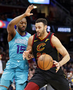 Cleveland Cavaliers' Larry Nance Jr., right, drives past Charlotte Hornets' Kemba Walker in the first half of an NBA basketball game, Tuesday, April 9, 2019, in Cleveland. (AP Photo/Tony Dejak)