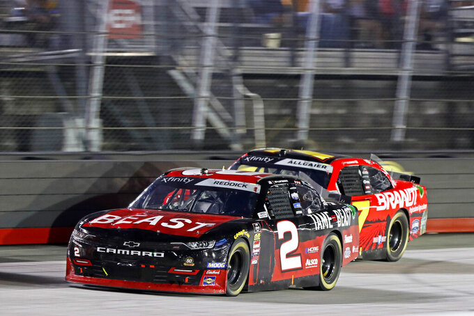 Tyler Reddick (2) leads Justin Allgaier (7) during the NASCAR Xfinity Series auto rac Friday, Aug. 16, 2019, in Bristol, Tenn. (AP Photo/Wade Payne)