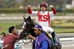 Irad Ortiz Jr. aboard Bricks and Mortar celebrates after winning the Breeders' Cup Turf horse race at Santa Anita Park, Saturday, Nov. 2, 2019, in Arcadia, Calif. (AP Photo/Gregory Bull)
