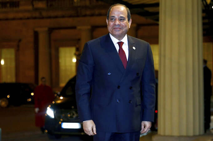 FILE - In this Jan. 20, 2020 file photo, Egypt's President Abdel Fattah al-Sisi arrives at Buckingham Palace for a reception to mark the UK-Africa Investment Summit in London.  A global watchdog and human rights lawyers on Friday, Oct. 2, 2020,  say that Egyptian authorities have arrested hundreds of people in their effort to clamp down on a spate of small but exceptionally rare protests across the country. (Henry Nicholls/Pool Photo via AP, File )