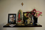 In this Sept. 18, 2019 photo, religious images decorate the kitchen at a migrant shelter in Monterrey, Mexico. Migrants waiting at the U.S.-Mexican border, in the Mexican state of Tamaulipas, recount harrowing stories of robbery, extortion by criminals and crooked officials, and kidnappings by competing cartels. (AP Photo/Fernando Llano)
