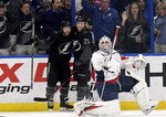 Tampa Bay Lightning Tyler Johnson (9) and Brayden Point (21) celebrate Johnson's first period goal as Washington Capitals goaltender Braden Holtby (70) watches the replay during an NHL hockey game Saturday, March 16, 2019, in Tampa, Fla. (AP Photo/Jason Behnken)