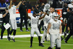 Las Vegas Raiders free safety Lamarcus Joyner (29) and teammates react after defeating the Los Angeles Chargers in an NFL football game Sunday, Nov. 8, 2020, in Inglewood, Calif. (AP Photo/Ashley Landis)