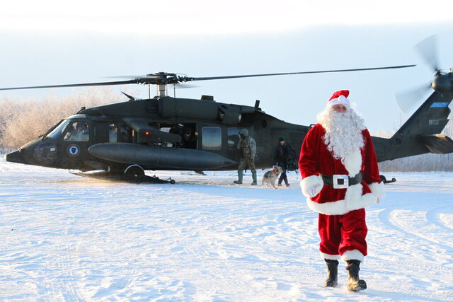 This Dec. 3, 2019 photo shows Santa Claus arriving in Napakiak, Alaska, on an Alaska National Guard UH-60 Black Hawk helicopter. The Guard brought its Operation Santa Claus to the western Alaska community, which is being severely eroded by the nearby Kuskokwim River. (AP Photo/Mark Thiessen)