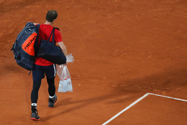 Britain's Andy Murray leaves after losing in three sets 1-6, 3-6, 2-6, against Switzerland's Stan Wawrinka in the first round match of the French Open tennis tournament at the Roland Garros stadium in Paris, France, Sunday, Sept. 27, 2020. (AP Photo/Christophe Ena)
