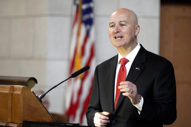 Nebraska Gov. Pete Ricketts delivers his annual State of the State address to lawmakers in Lincoln, Neb., Wednesday, Jan. 15, 2020. (AP Photo/Nati Harnik)