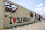 In this photo provided by News21, graffiti on a destroyed building welcomes passersby, Monday, June 3, 2019, into Panama City, Fla. (Peter Nicieja/News21 via AP)