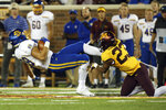 South Dakota State tight end Blake Kunz (88) is tackled by Minnesota defensive back Jordan Howden (23) during an NCAA college football game Thursday, Aug. 29, 2019, in Minneapolis. (AP Photo/Stacy Bengs)