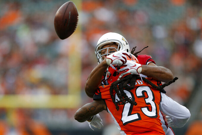 Cincinnati Bengals cornerback B.W. Webb (23) breaks up a pass to Arizona Cardinals wide receiver Larry Fitzgerald, above, in the second half of an NFL football game, Sunday, Oct. 6, 2019, in Cincinnati. (AP Photo/Gary Landers)