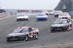 Brad Keselowski (2) leads the pack around Turn 1 during the second lap of a NASCAR Cup Series auto race in Watkins Glen, N.Y., on Sunday, Aug. 8, 2021. (AP Photo/Joshua Bessex)