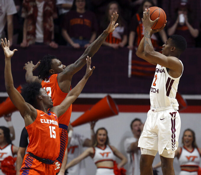 Virginia Tech's Landers Nolley II (2) shoots over Clemson defenders John Newman III (15) and Tevin Mack (13) during the first half of an NCAA college basketball game Wednesday, March 4, 2020, in Blacksburg, Va. (Matt Gentry/The Roanoke Times via AP)