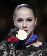 Russia's Alina Zagitova kisses her gold medal for the ladies free skating during the ISU World Figure Skating Championships at Saitama Super Arena in Saitama, north of Tokyo, Friday, March 22, 2019. (AP Photo/Andy Wong)