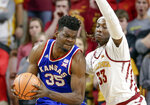 Kansas' Udoka Azubuike (35) is guarded by Iowa State's Solomon Young (33) during the first half of an NCAA college basketball game in Ames, Iowa, Tuesday, Feb. 13, 2018. (AP Photo/Nati Harnik)