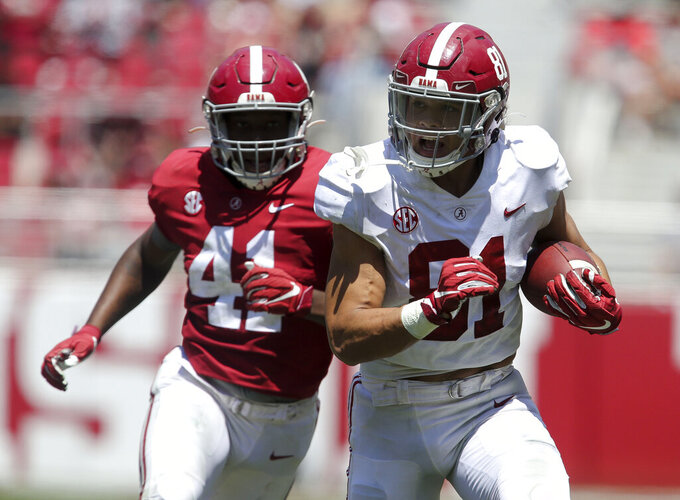 White team tight end Cameron Latu (81) scores after catching a pass from Bryce Young during Alabama's spring NCAA college football game at Bryant-Denny Stadium, Saturday, April 17, 2021, in Tuscaloosa, Ala. (Gary Cosby/The Tuscaloosa News via AP)