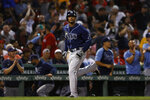 Tampa Bay Rays' Wander Franco heads home to score on a three-run home run by Jordan Luplow during the seventh inning of the team's baseball game against the Boston Red Sox on Tuesday, Sept. 7, 2021, at Fenway Park in Boston. (AP Photo/Winslow Townson)