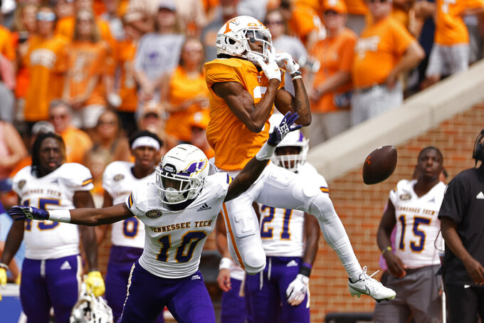 Tennessee wide receiver JaVonta Payton (3) can't hang onto the ball as Tennessee Tech defensive back Cameron Hudson (10)  defends during the first half of an NCAA college football game Saturday, Sept. 18, 2021, in Knoxville, Tenn. (AP Photo/Wade Payne)