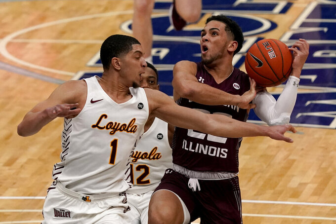 Southern Illinois' Steven Verplancken Jr., right, heads to the basket as Loyola of Chicago's Lucas Williamson (1) defends during the first half of an NCAA college basketball game in the quarterfinal round of the Missouri Valley Conference men's tournament Friday, March 5, 2021, in St. Louis. (AP Photo/Jeff Roberson)