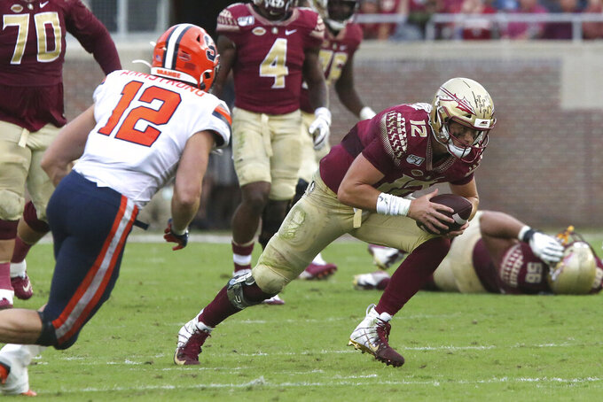 Florida State's quarterback Alex Hornibrook, right, runs for first down yardage as Syracuse's Andrew Armstrong closes in to make the tackle during the second quarter of an NCAA college football game, Saturday, Oct. 26, 2019 in Tallahassee Fla. (AP Photo/Steve Cannon)