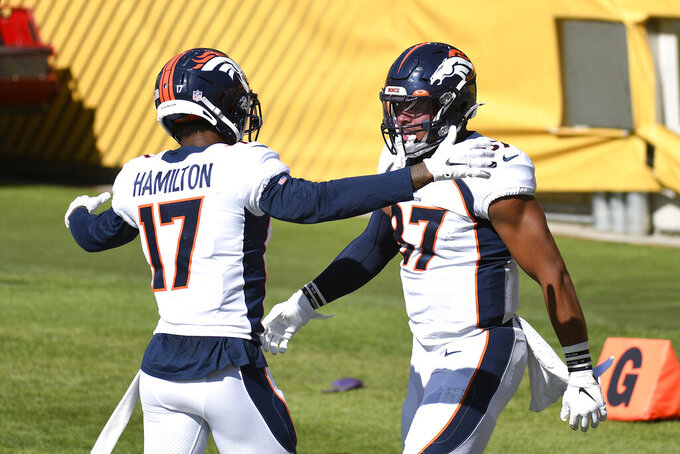Denver Broncos tight end Noah Fant, right, celebrates his touchdown with DaeSean Hamilton, left, during the second half of an NFL football game in Pittsburgh, Sunday, Sept. 20, 2020. (AP Photo/Don Wright)