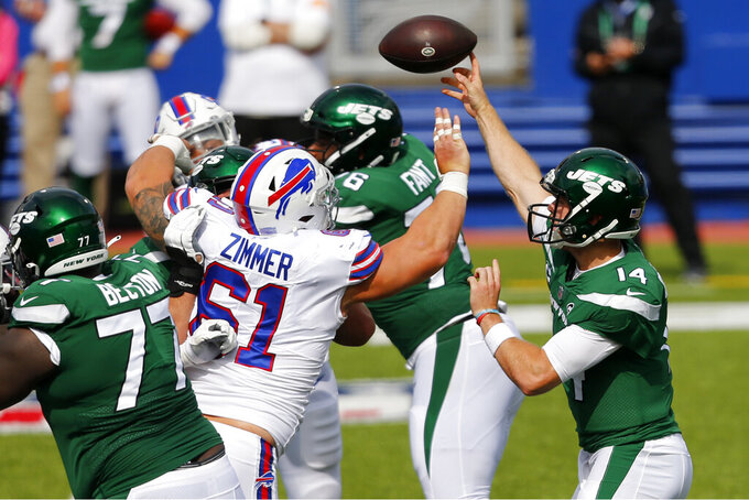 New York Jets quarterback Sam Darnold (14) throws a touchdown pass to Jamison Crowder during the second half of an NFL football game against the Buffalo Bills in Orchard Park, N.Y., Sunday, Sept. 13, 2020. (AP Photo/Jeffrey T. Barnes)