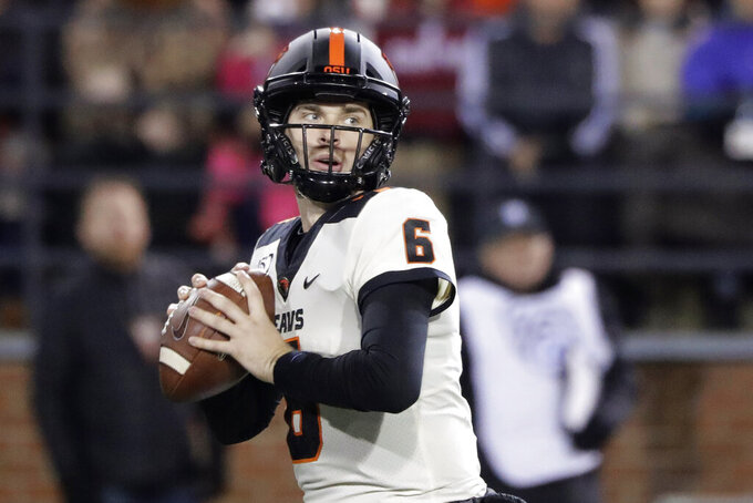 Oregon State quarterback Jake Luton looks for a receiver during the first half of the team's NCAA college football game against Washington State, Saturday, Nov. 23, 2019, in Pullman, Wash. (AP Photo/Ted S. Warren)