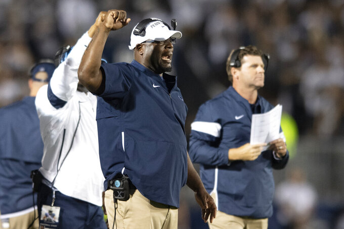 FILE - In this Sept. 7, 2019, file photo, then-Penn State defensive line coach Sean Spencer talks with his players in the second quarter of an NCAA college football game against Buffalo in State College, Pa. After spending more than two decades in the college ranks as an assistant coach, Sean Spencer is bringing his high-energy approach to the New York Giants. Spencer has a big personality and the Giants defensive linemen are learning it first hand.  (AP Photo/Barry Reeger, File)