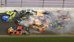 Multiple cars crash in turn 3 during the NASCAR Daytona 500 auto race at Daytona International Speedway, Sunday, Feb. 17, 2019, in Daytona Beach, Fla. (AP Photo/Gary McCullough)