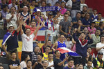 Supporters for France cheer during a quarterfinal match against United States for the FIBA Basketball World Cup in Dongguan in southern China's Guangdong province on Wednesday, Sept. 11, 2019. France defeated United States 89-79. (AP Photo/Ng Han Guan)