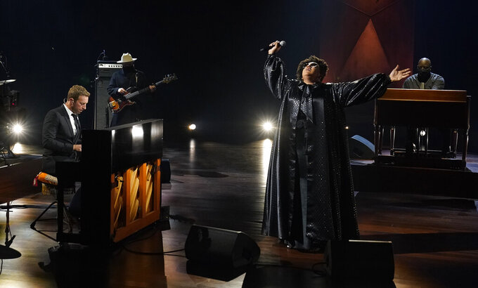 """Chris Martin, left, and Brittany Howard perform together during the """"In Memoriam"""" section of the 63rd Grammy Awards at the Los Angeles Convention Center, Tuesday, March 9, 2021. The awards show airs on March 14 with both live and prerecorded segments. (AP Photo/Chris Pizzello)"""