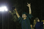 A senior celebrates after receiving his diploma during graduation ceremonies at Paradise High School in Paradise, Calif., Thursday June 6, 2019. Most of the students of Paradise High lost their homes when the Camp Fire swept through the area and the school was forced to hold classes in Chico. The seniors gathered one more time at Paradise High for graduation ceremonies. (AP Photo/Rich Pedroncelli)
