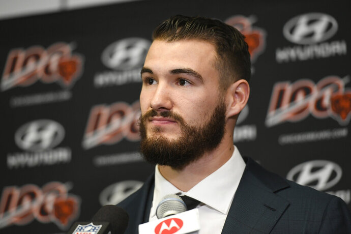 """FILE - In this Dec. 29, 2019, file photo, Chicago Bears quarterback Mitchell Trubisky speaks during a news conference after an NFL football game against the Minnesota Vikings, in Minneapolis. Trubisky understands why the Bears acquired quarterback Nick Foles. That doesn't mean he's ready to hand over the starting job. Trubisky said the trade for Foles gave him extra motivation to show he can develop into the franchise quarterback the Bears thought he would become when they moved up a spot to draft him with the No. 2 overall pick in 2017. """"That's the business we're in,"""" he said in a conference call on Friday, June 12, 2020. (AP Photo/Craig Lassig, File)"""