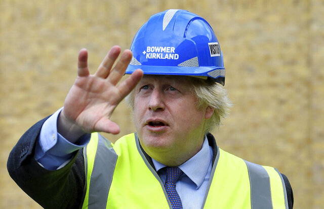 Britain's Prime Minister Boris Johnson visits the construction site of Ealing Fields High School in west London, Monday June 29, 2020. (Toby Melville/Pool via AP)