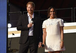 Prince Harry, the Duke of Sussex, left, and Meghan, the Duchess of Sussex speak at Global Citizen Live in Central Park on Saturday, Sept. 25, 2021, in New York. Global Citizen Live, a 24-hour concert that featured performances from Stevie Wonder, Jennifer Lopez, BTS and Elton John and dozens of other stars, raised $1.1 billion in commitments and pledges over the weekend to fight extreme poverty. Broadcasting from sites on six continents, including New York's Central Park and in front of the Eiffel Tower in Paris, Global Citizen also secured pledges from France for 60 million COVID-19 vaccine doses for developing countries and corporate pledges for planting 157 million trees around the world. Vaccine pledges, which also came from the governments of Croatia and Ireland, followed numerous pleas, including from Prince Harry and Meghan, the Duke and Duchess of Sussex, onstage at Central Park on Saturday. (Photo by Evan Agostini/Invision/AP)