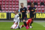 Leipzig's Timo Werner celebrates scoring their fourth goal during a German Bundesliga soccer match between FSV Mainz 05 and RB Leipzig in Mainz, Germany, Sunday, May 24, 2020.  (Kai Pfaffenbach/pool via AP)