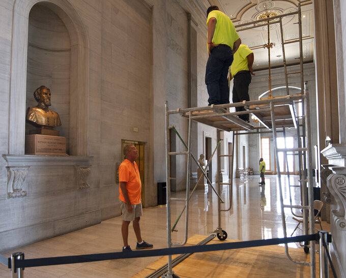 Workers prepare scaffolding in front of a bust of Confederate general and early Ku Klux Klan leader Nathan Bedford Forrest at the State Capitol, Thursday, July 22, 2021, in Nashville, Tenn. A decades-long effort to remove the bust from the Tennessee Capitol cleared its final hurdle Thursday, with state leaders approving the final vote needed to allow the statue to be relocated to a museum. (George Walker IV/The Tennessean via AP)