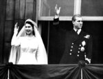 FILE - In this Nov. 20, 1947 file photo, Britain's Princess Elizabeth and Prince Philip wave to the crowds on their wedding day, from the balcony of Buckingham Palace in London. There certainly won't be fuss. Count on that. When Britain's Prince Philip reaches the grand age of 99 on Wednesday, he will spend it quietly and in much the same way he's spent most of his adult life: beside Queen Elizabeth II. (AP Photo/File)