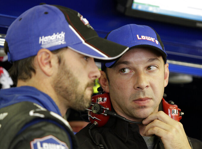 FILE - In this July 15, 2011, file photo, driver Jimmie Johnson, left, talks with crew chief Chad Knaus during practice for the NASCAR Lenox Industrial Tools 300 auto race at New Hampshire Motor Speedway in Loudon, N.H. Knaus is only five years older than Johnson and the two grew up in the Cup Series together.(AP Photo/Mary Schwalm, File)
